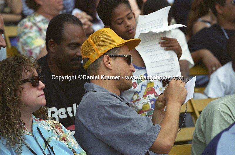 Actor Woody Harrelson signs autographs on March 28, 1999 as the Baltimore Orioles of Major League Baseball defeated the Cuban national baseball team at the Estadio Latinoamericano in Havana, Cuba in the first oftwo exhibition games played between the two teams. This game marked the first time that a MLB team played in Cuba since 1959.
