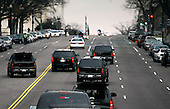Washington, DC - January 5, 2008 -- United States President-elect Barack Obama's motorcade drives along Constitution Avenue near the U.S. Capitol before his meeting with Speaker of the House Rep. Nancy Pelosi (D-CA), Monday, January 5, 2009 in Washington, DC. The Obama family moved to the capital over the weekend so the daughters could begin school in Washington today. Obama met with Pelosi and will meet with his top economic advisors to begin work on a stimulus package that they hope will include hundreds of billions of dollars worth of tax breaks for individuals and businesses. .Credit: Chip Somodevilla - Pool via CNP