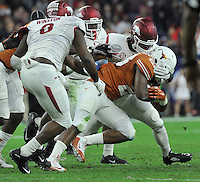 NWA Media/Michael Woods --12/29/2014-- w @NWAMICHAELW...University of Arkansas linebacker Braylon Mitchell takes down Texas running back Malcom Brown in the 1st quarter of the Texas Bowl Monday night at  NRG Stadium in Houston.