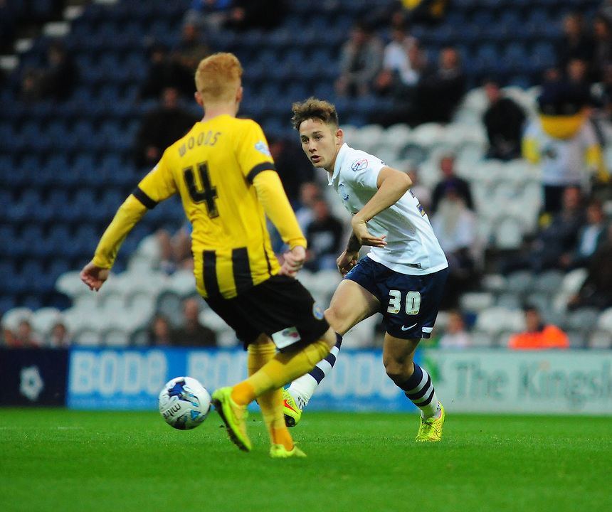 Preston North End's Josh Brownhill looks to play the ball past Shrewsbury Town's Ryan Woods<br /> <br /> Photographer Chris Vaughan/CameraSport<br /> <br /> Johnstone's Paint Northern Area First Round - Preston North End v Shrewsbury Town - Tuesday 2nd September 2014 - Deepdale - Preston<br />  <br /> &copy; CameraSport - 43 Linden Ave. Countesthorpe. Leicester. England. LE8 5PG - Tel: +44 (0) 116 277 4147 - admin@camerasport.com - www.camerasport.com