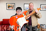 Tralee woman Mary Hogan is offering to donate her prized fender squire guitar which dates back to the late 1950s to help raise funds for a Tralee 1916 commemoration event next month also in photo is Tommy Collins.