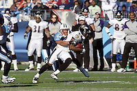 Titans cornerback Cortland Finnegan attempts to tackle Ravens wide receiver Derrick Mason on a 9 yard pass play in the third quarter at LP Field in Nashville, Tennessee on November 12, 2006. The Baltimore Ravens won 27-26.
