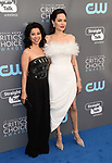 SANTA MONICA, CA - JANUARY 11: Writer Loung Ung (L) and actor/director Angelina Jolie attend The 23rd Annual Critics' Choice Awards at Barker Hangar on January 11, 2018 in Santa Monica, California.