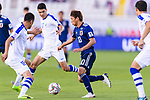 Takashi Inui of Japan (R) competes for the ball with Fozil Musaev (L) and Dostonbek Khamdamov of Uzbekistan (C) during the AFC Asian Cup UAE 2019 Group F match between Japan (JPN) and Uzbekistan (UZB) at Khalifa Bin Zayed Stadium on 17 January 2019 in Al Ain, United Arab Emirates. Photo by Marcio Rodrigo Machado / Power Sport Images