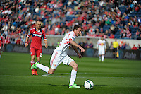 New York midfielder Eric Alexander (12) dribbles toward the Chicago goal.  The Chicago Fire defeated the New York Red Bulls 3-1 at Toyota Park in Bridgeview, IL on April 7, 2013.