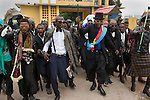 "KINSHASA, DEMOCRATIC REPUBLIC OF CONGO - FEBRUARY 10: Young Sapeurs parade and show their designer label clothes while paying their respect to Stervos Nyarcos, the founder of the .kitendi religion., which means clothing in local language Lingala. Nyarcos was known as the leader of the Sape movement, at Gombe cemetery on February 10, 2016 in Kinshasa, DRC. The word Sapeur comes from SAPE, a French acronym for Société des Ambianceurs et Persons Élégants. or .Society of Revellers and Elegant People. and it also means, .to dress with elegance and style"". Most of the young Sapeurs are unemployed, poor and live in harsh conditions in Kinshasa,  a city of about 10 million people. For many of them being a Sapeur means they can escape their daily struggles and dress like fashionable Europeans. Many hustle to build up their expensive collections. Most Sapeurs could never afford to visit Paris, and usually relatives send or bring clothes back to Kinshasa. (Photo by Per-Anders Pettersson)"
