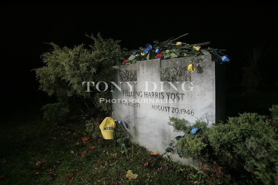 """Michigan alum Jeff Holzhausen, aka """"Superfan I"""", leads a group of Michigan students and fans on an annual pilgrimage to visit the graves of former Michigan football greats Fielding H. Yost and Bob Ufer, on Thursday, November 16, 2006 in Ann Arbor, MI. TONY DING/Special to the Free Press"""