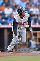 Toledo Mud Hens center fielder Ezequiel Carrera #8 swings at a pitch during a game against the Durham Bulls at Durham Bulls Athletic Park on July 25, 2014 in Durham, North Carolina. The Mud Hens defeated the Bulls 5-3. (Tony Farlow/Four Seam Images)