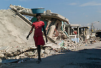 Port Au Prince, Haiti, Jan 27 2010.Two weeks after the disaster, most inhabitants of Port au Prince are beginning to try and clean up the rubble of their homes, but their needs are immense.