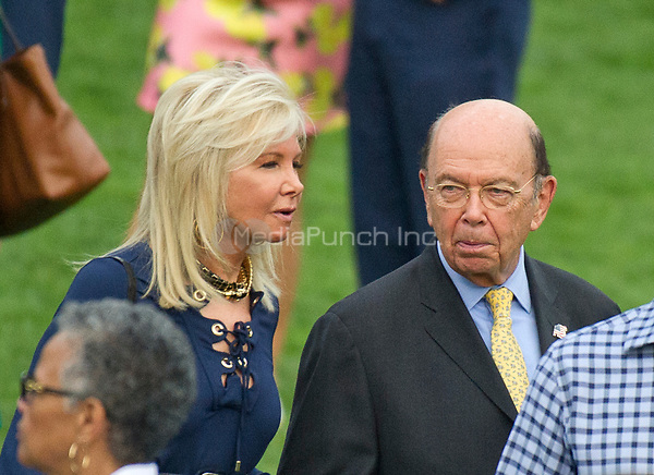 United States Secretary of Commerce Wilbur Ross and his wife, Hilary, on the South Lawn of the White House in Washington, DC prior to the arrival of US President Donald J. Trump and first lady Melania Trump for the annual Congressional Picnic on the South Lawn of the White House in Washington, DC on Thursday, June 22, 2017.<br /> Credit: Ron Sachs / CNP /MediaPunch