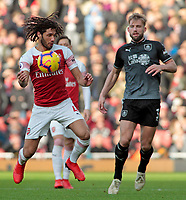 Arsenal's Mohamed Elneny controls the ball under pressure from Burnley's Charlie Taylor<br /> <br /> Photographer David Shipman/CameraSport<br /> <br /> The Premier League - Arsenal v Burnley - Saturday 22nd December 2018 - The Emirates - London<br /> <br /> World Copyright © 2018 CameraSport. All rights reserved. 43 Linden Ave. Countesthorpe. Leicester. England. LE8 5PG - Tel: +44 (0) 116 277 4147 - admin@camerasport.com - www.camerasport.com