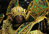 A member of Grande Rio samba school performs during parade at the Sambadrome, Rio de Janeiro, Brazil, March 2, 2014.  (Austral Foto/Renzo Gostoli)