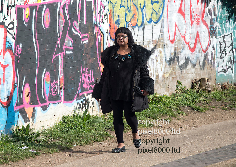 Pic shows: MP Diana Abbott spotted on a fitness walk in Victoria Park  in Hackney East London.<br /> <br /> The portly Labour firebrand packed her Iphone and donned headphones alongside a trendy faux fur collared jacket,  then walked several miles to and from her home in Hackney on a freezing Sunday morning. <br /> <br /> No doubt all in an effort to shed a few pounds.<br /> <br /> She could not quite manage the exertions of the lycra clad cyclists and jogger but at least she was trying.<br /> <br /> Sadly Diane, who wants to impose restrictions on fried chicken outlets and chip shops, rather spoilt the effort by pitstopping at the Pavilion cafe, next to the park lake and tucking into £10 English breakfast of sausages beans and 2 toast, washed down with a cup of black coffee and finished off with a cinamon bun at £2.50.<br /> She couldn't quite manage the last sausage but never fear she wrapped it in a serviette and took it home with her for later.<br /> <br /> She also got a takeway cup of coffee for the trek home along the graffiti daubed towpath of the Regent's Canal back to her  trendy Hackney home.<br /> <br /> The distance there and back would be well over 5 miles. <br /> <br /> <br /> picture by Gavin Rodgers/ Pixel
