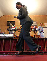 Immacule Nyirabeza begins to jump up and down to the music during Sunday service at The Africa Lighthouse Baptist Temple near Stony Point in Albemarle County, VA. The small 10 family congregation is made up of African refugees and immigrants who's service is spoken in Swahili and translated into English. They've just signed a rent-own lease for a small church after meeting for three years at a local school. Photo/The Daily Progress/Andrew Shurtleff