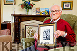 Michael O'Connor  from Killarney is 102 Year Old here holding a pictured of him and his Wife Joan on their wedding day