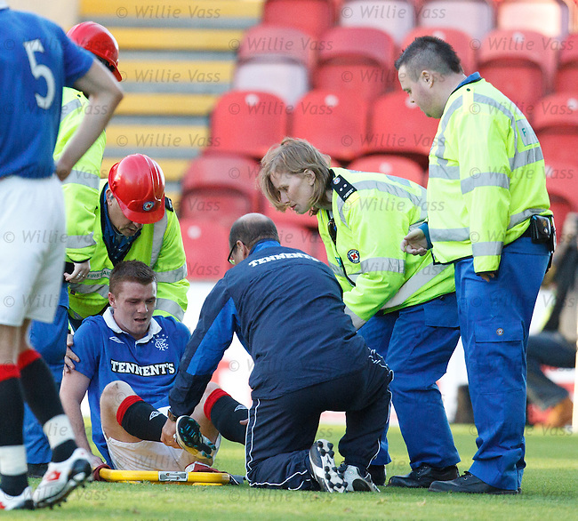 John Fleck in agony as he is stretchered off the park by medical staff