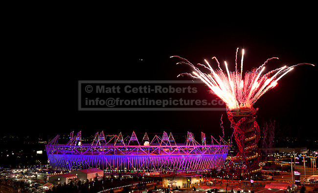 28/07/2012. LONDON, UK. Fireworks explode from the top of the ArcelorMittal Orbit next to the Olympic Stadium as the final phases of the opening ceremony of the 2012 Summer Olympics take place in London today (28/07/12). Constituting the third time the Olympic Games have been held in Great Britain, the 2012 Olympic Games, also known as the Games of the XXX Olympiad opened this evening with a show, put together by 'Slum Dog Millionaire' director Danny Boyle, entitled 'The Isles of Wonder. Photo credit: Matt Cetti-Roberts