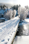 A snow covered bridge crosses Flat Creek in the town of Jackson, Wyoming.