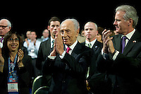 President of Israel Shimon Peres acknowledges his being named to receive the Presidential Medal of Freedom from United States President Barack Obama during Obama's opening remarks at the American Israel Public Affairs Committee (AIPAC) Policy Conference in Washington, D.C. on Sunday, March 4, 2012.  At left is the Ambassador of Israel Michael Oren..Credit: Ron Sachs / Pool via CNP /MediaPunch