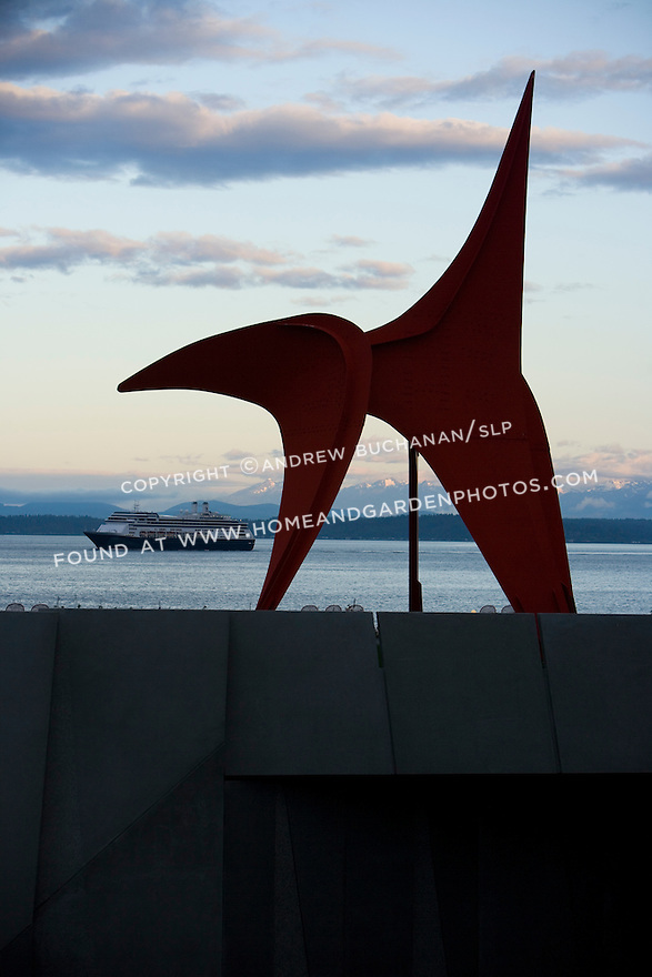 """With the snow-capped Olympic Mountains looming some 40+ miles away, the iconic shape of Alexander Calder's, """"Eagle, 1971"""" stands silhouetted against a Northwest sunrise.  SAM's Olympic Sculpture Park, Seattle, WA."""