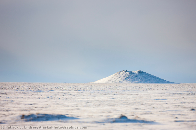 A geological formation called a pingo on the tundra of Alaska's arctic north slope