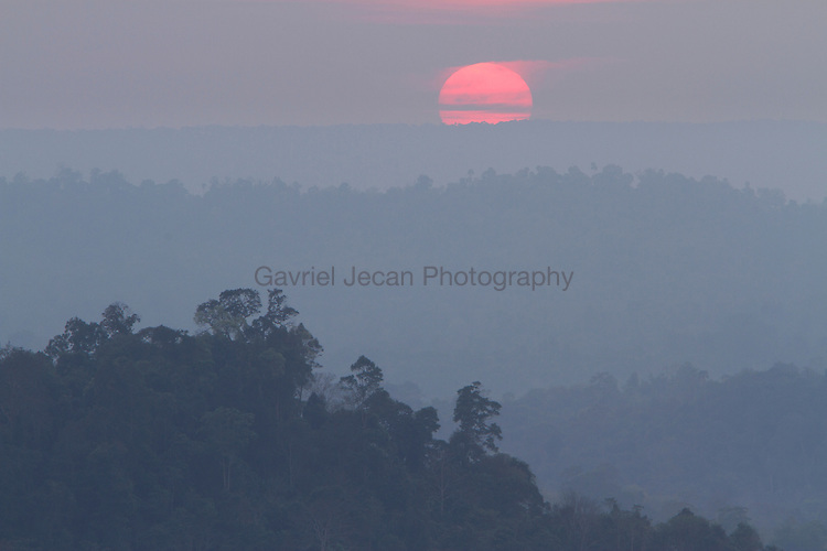 SUNSET OVER THE RAIN FOREST OF THAILAND