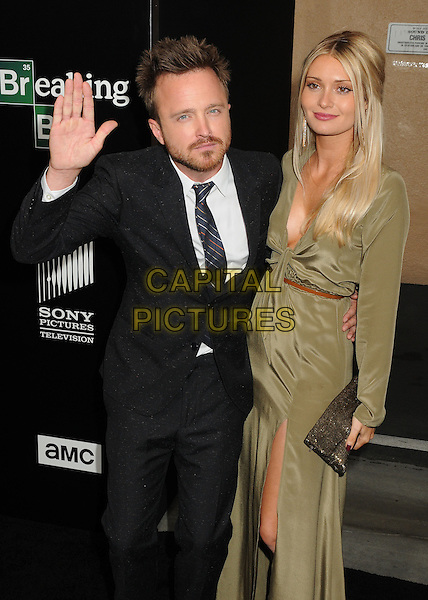 Aaron Paul, Lauren Parsekian<br /> &quot;Breaking Bad&quot; Final Episodes Los Angeles Premiere Screening held at Sony Pictures Studios, Culver City, California, USA, 24th July 2013.<br /> half length grey gray black suit tie hand waving green khaki dress <br /> CAP/ADM/BP<br /> &copy;Byron Purvis/AdMedia/Capital Pictures
