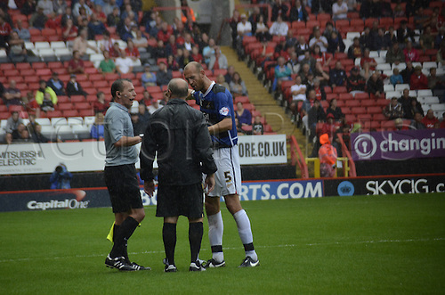 24.08.2013. The Valley, Charlton, London, England. FA Championship football. Charlton FC versus Doncaster Rovers.  Rob Jones argues about the game being abandoned