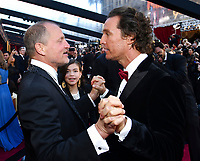 Woody Harrelson, left, and Matthew McConaughey greet each other at the Oscars on Sunday, March 4, 2018, at the Dolby Theatre in Los Angeles. (Photo by Charles Sykes/Invision/AP)