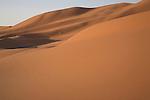 Camel trekking through the sand dunes of Merzouga, Morocco