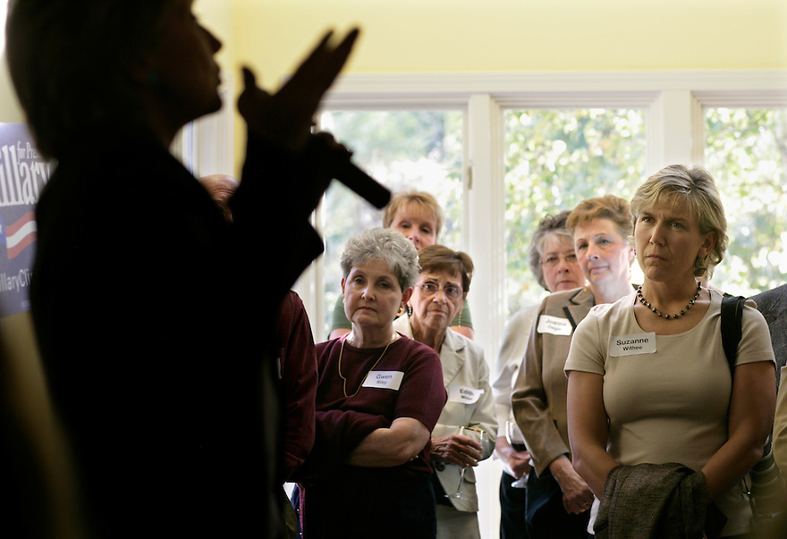 Women listen as Democratic presidential candidate Hillary Clinton speaks at a house party in Bedford, NH.<br /> Photo by Brooks Kraft/Corbis