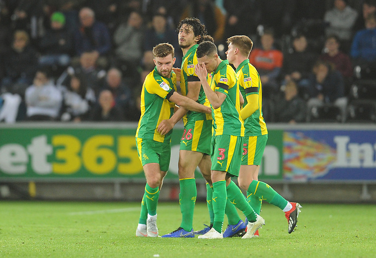 West Bromwich Albion's Ahmed Hegazi (second left) celebrates scoring his side's second goal with team-mates<br /> <br /> Photographer Kevin Barnes/CameraSport<br /> <br /> The EFL Sky Bet Championship - Swansea City v West Bromwich Albion - Wednesday 28th November 2018 - Liberty Stadium - Swansea<br /> <br /> World Copyright &copy; 2018 CameraSport. All rights reserved. 43 Linden Ave. Countesthorpe. Leicester. England. LE8 5PG - Tel: +44 (0) 116 277 4147 - admin@camerasport.com - www.camerasport.com