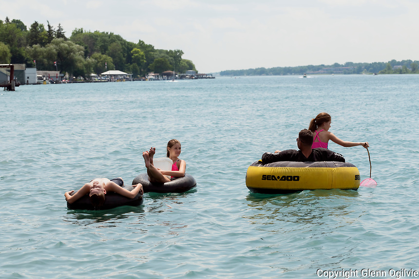 """Spending five days visiting grandparents along the St. Clair River has totally captivated an Arizona family. Steve Ringenback and his children Saray, on the tube with him, Stockton and Shailey, pink, inner tube, have spent a good portion of their visit floating down the river enjoying the scenery. """"It's just beautiful,"""" Steve said as he looked over the river to Stag Island."""