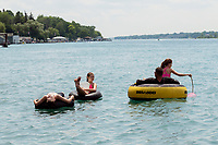 "Spending five days visiting grandparents along the St. Clair River has totally captivated an Arizona family. Steve Ringenback and his children Saray, on the tube with him, Stockton and Shailey, pink, inner tube, have spent a good portion of their visit floating down the river enjoying the scenery. ""It's just beautiful,"" Steve said as he looked over the river to Stag Island."
