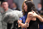 Master Sgt. Christian Riege's fiance Stacia Greene is consoled by an unidentified friend before a memorial ceremony in Carson City, Nev., on Sunday, Sept. 11, 2011. Three Nevada National Guard members who were killed earlier this week by a gunman in an IHOP restaurant were honored during the private ceremony. (AP Photo/Cathleen Allison)