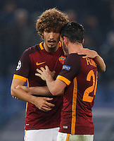 Calcio, Champions League: Gruppo E - Roma vs Bate Borisov. Roma, stadio Olimpico, 9 dicembre 2015.<br /> Roma's Alessandro Florenzi, right, talks to his teammate Salih Ucan at the end of the Champions League Group E football match between Roma and Bate Borisov at Rome's Olympic stadium, 9 December 2015. Roma drawed 0-0 against Bate to join the round of 16 with a mere six points.<br /> UPDATE IMAGES PRESS/Riccardo De Luca