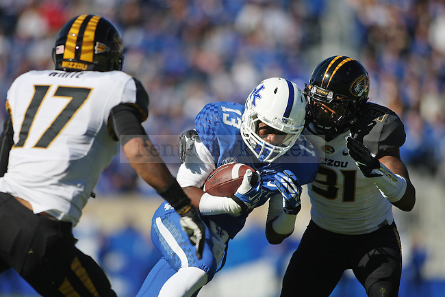 Kentucky Wildcats wide receiver Jeff Badet (13) runs past Missouri Tigers safety Matt White (17) and Missouri Tigers defensive back E.J. Gaines (31) during the first half of the University of Kentucky vs. Missouri University football game at Commonwealth Stadium in Lexington, Ky., on Saturday, November 9, 2013. Missouri defeated Kentucky 48-17. Photo by Michael Reaves | Staff