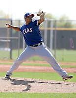 Jose Monegro of the Texas Rangers  plays in a minor league spring training game against the San Diego Padres at the Rangers complex on March 26, 2011  in Surprise, Arizona. .Photo by:  Bill Mitchell/Four Seam Images.