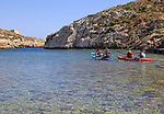 Kayaking shoreline clear blue sea water, Mgarr ix-Xini coastal inlet, island of Gozo, Malta