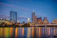 Austin skyline was taken from the town lake hike and bike trail in Austin at night you can see the lights reflecting into the water  from the buildings like the frost and Austionion and W as rower club row by.