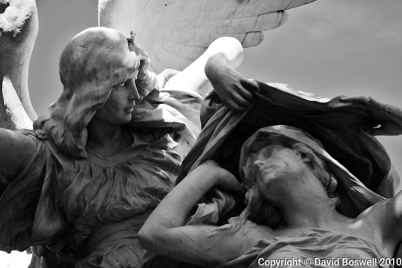 A sculpture decorates a tomb in the Cementario de la Recoleta in Buenos Aires.