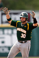 Baylor Bears catcher Josh Ludy #30 gestures to his dugout after he doubled during the NCAA Regional baseball game against Oral Roberts University on June 3, 2012 at Baylor Ball Park in Waco, Texas. Baylor defeated Oral Roberts 5-2. (Andrew Woolley/Four Seam Images)