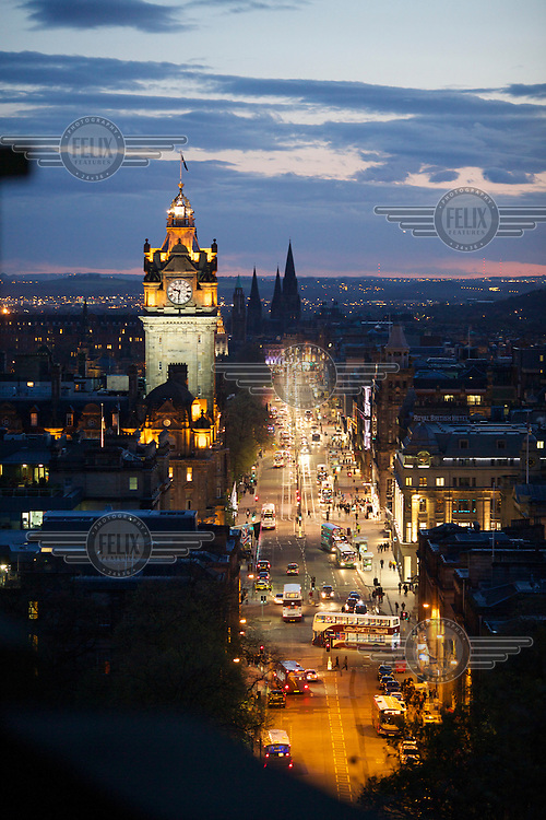 A view of Princes Street at dusk as seen from Carlton Hill, where the Beltane Fire Festival is celebrated each year on the evening of 30 April. <br /> The Beltane Festival is an annual event when winter is purged by fire. From sunset on 30 April until early morning, over 300 volunteers create a dramatic reimagining of pagan gaelic folklore surrounded by a crowd of 6000 people. The May Queen arises to herald summer through a battle between elemental forces of order and chaos reaching a climax in the death of the green man in his winter form before bringing him back to life.