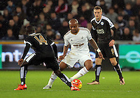 Andre Ayew of Swansea (C) against N'Golo Kante of Leicester City (L) during the Barclays Premier League match between Swansea City and Leicester City at the Liberty Stadium, Swansea on December 05 2015