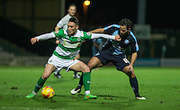 Connor Roberts of Yeovil Town holds off Sam Wood of Wycombe Wanderers during the Sky Bet League 2 match between Yeovil Town and Wycombe Wanderers at Huish Park, Yeovil, England on 24 November 2015. Photo by Andy Rowland.