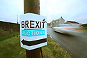 "An anti Brexit Auction sign point to one of many border crossing at the Irish Border in South Armagh, Northern Ireland, 18 Jan 2019. The Irish prime minister, Leo Varadkar, has raised the prospect of uniformed police or soldiers being deployed to the border with Northern Ireland (Jan25, 2019) in the event of a chaotic and disorderly Brexit. In the most explicit warning yet of the consequences of a no-deal Brexit he said in a worst-case scenario, a hard border could ""involve people in uniform and it may involve the need, for example, for cameras, physical infrastructure, possibly a police presence, or an army presence to back it up"". Photo/Paul McErlane"
