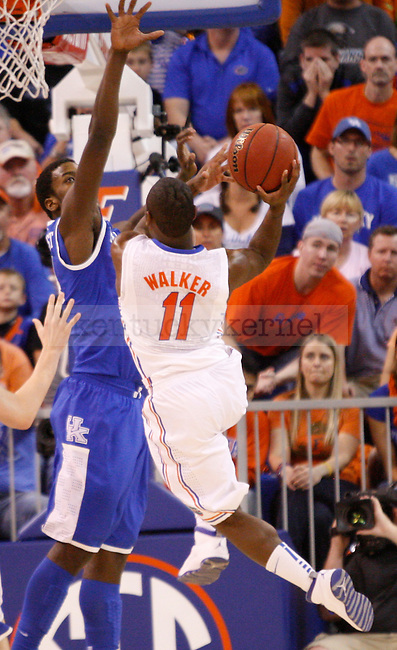 UK forward Michael Kidd-Gilchrist attempts to block Florida's Erving Walker shot during the second half of the University of Kentucky's men basketball game against University of Florida 3/4/12 at the O'Connell Center in Gainesville, Fl. Photo by Quianna Lige | Staff