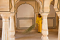 India,  Jaipur, Rajasthani woman cleaning a pillar hall at Jaipur Fort