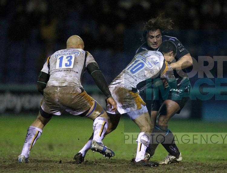 Sebastien Bruno of Sale Sharks tackled by Shane Drahm of Worcester