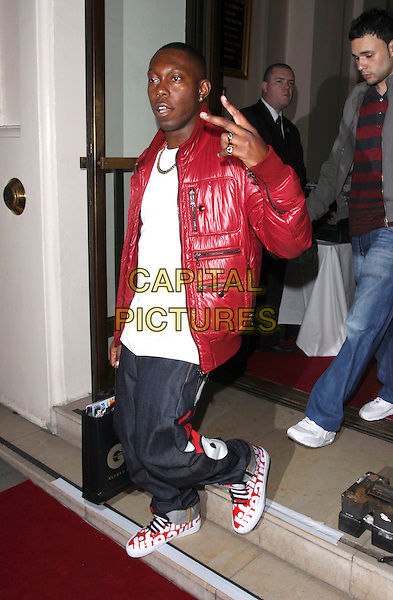 DIZZEE RASCAL (Dylan Kwabena Mills).Attending the GQ Men Of The Year Awards 2009 held at the Royal Opera House, Covent Garden, London, England, UK, September 8th 2009. .departures leaving full length red jacket puffer puffa v gesture hand peace sign jeans trainers white laces bag .CAP/AH.©Adam Houghton/Capital Pictures.